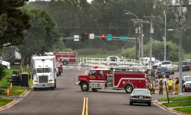 Sauk Rapids Fire Department vehicles block a a section of Stearns Drive near the intersection with Second Street North after a report of a gas leak Monday, Aug. 26, 2019, in Sauk Rapids.