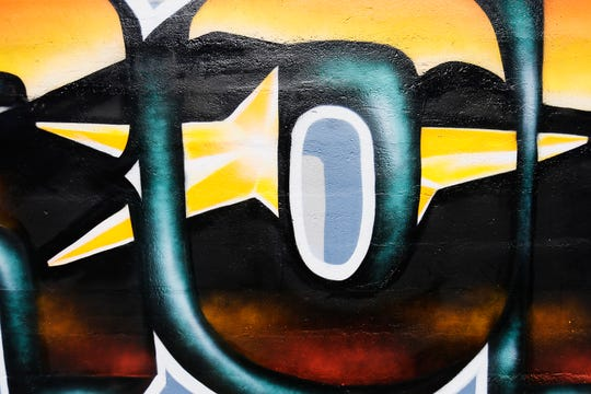 Edmundo Portillo, Vice President of Cadence mortgage company, talks about the El Paso Strong mural they had done by local artist Gabe Vasquez Monday, Aug. 26, in the parking lot of Cadence mortgage company in El Paso.