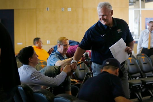 UTEP head football coach Dana Dimel walks through the aisles of reporters after he speaks at a press conference prior to the game against Huston Baptist Monday, Aug. 26, at the Larry K. Durham Center in El Paso.