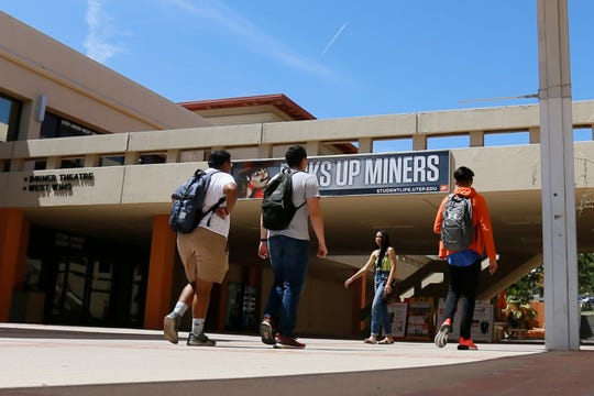 Students walk at the University of Texas at El Paso on the first day of the fall semester Monday, Aug. 26, 2019.