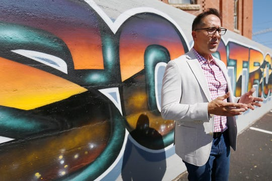 """Edmundo Portillo, vice president of Cadence mortgage company, talks about the """"El Paso Strong"""" mural the company had done by local artist Gabe Vasquez on Monday, Aug. 26, 2019, in the company's parking lot at 211 W. Yandell Drive in El Paso."""