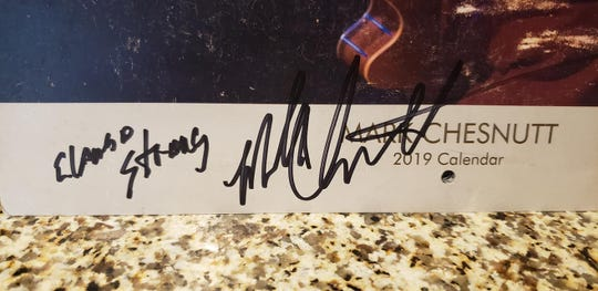 Mark Chesnutt was happy to sign El Paso Strong for a fan Saturday during his meet and greet.