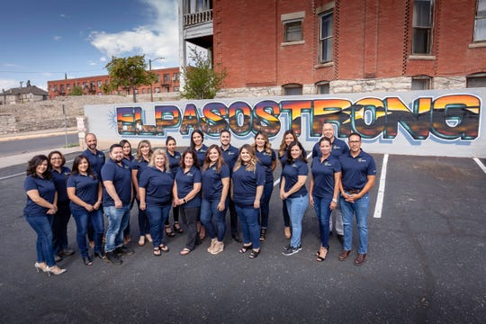 """The staff at Cadence mortgage company is proud to add this """"El Paso Strong"""" mural to the retaining wall at the business at 211 W. Yandell Drive."""