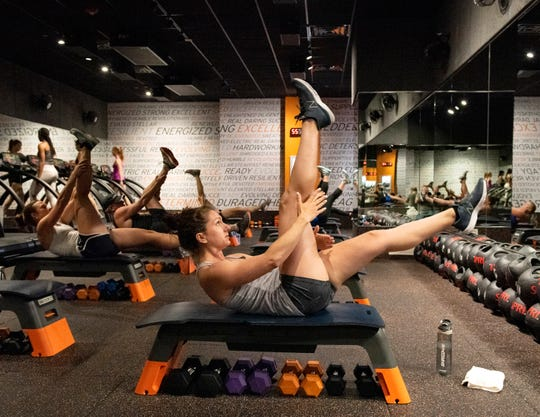 A group works out during a midday class at Shred 415 in Greenville.
