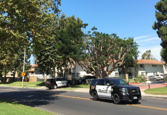 Patrol vehicles from the Ventura County Sheriff's Office are parked on Paseo Camarillo in Camarillo Monday morning after a search for a suspect in a domestic violence incident.