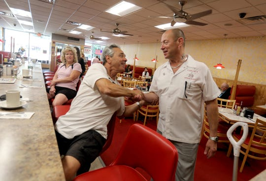 George Hogan, right, owner of Hogan's Nyack Diner, greets long time customer Guy Gebbia of Upper Nyack Aug. 26, 2019. Hogan, who has owned the diner for eleven years, is retiring and has sold the restaurant to new owners.