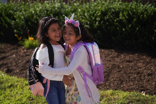Students reunite with classmates on the first day of school at  Marbrook Elementary School on Monday morning.