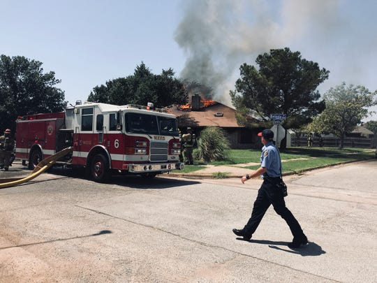 Wichita Falls firefighters battled a two-alarm fire on Belinda Drive, near McNiel Middle School and Memorial Stadium, through the lunch hour Monday.