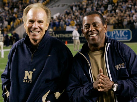 Former Navy midshipmen and Dallas Cowboys quarterback Roger Staubach, left, stands with former Pittsburgh running back Tony Dorsett on the sidelines before the Pittsburgh vs. Navy college football game in 2007.
