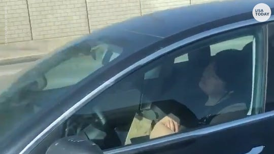 Video appears to show Tesla driver 'literally asleep at the wheel'