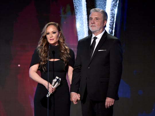 Former Scientology members Leah Remini and Mike Rinder accept The Impact Award during the Critics' Choice Real TV Awards in June.