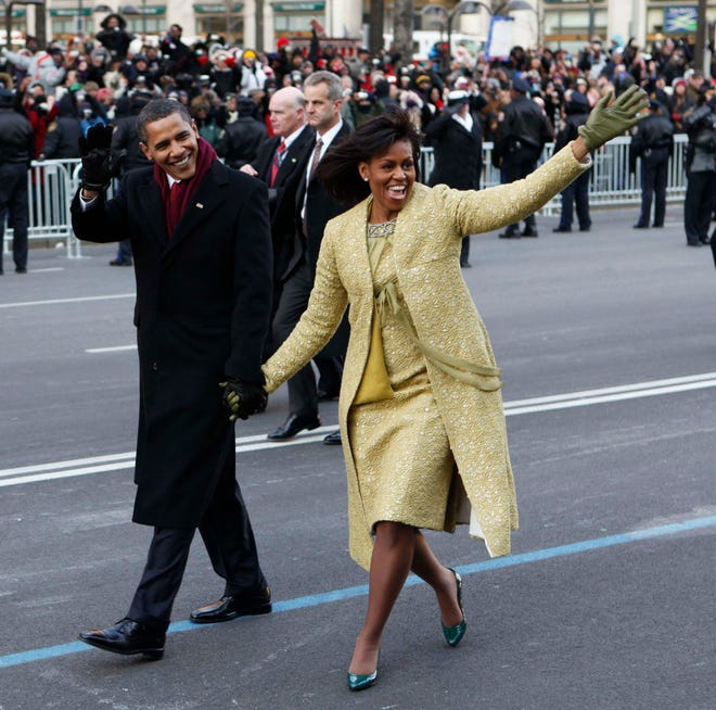 President Barack Obama and first lady Michelle Obama, wearing Isabel Toledo, in the 2009 inaugural parade route in Washington.