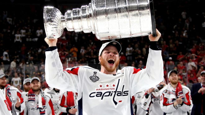 John Carlson holding the Stanley Cup