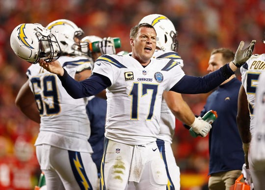 epa07230158 Los Angeles Chargers quarterback Philip Rivers reacts to the officials after a call in the second half of the NFL American football game at between the Los Angeles Chargers and the Kansas City Chiefs at Arrowhead Stadium in Kansas City, Missouri, USA, 13 December 2018.  EPA-EFE/LARRY W. SMITH ORG XMIT: LWS129