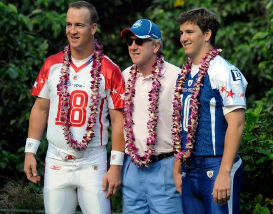Archie Manning, center, with sons Peyton Manning and Eli Manning in 2009.