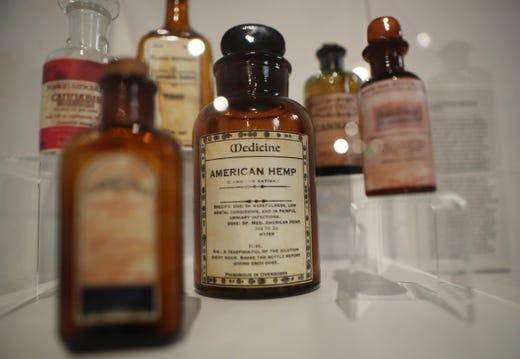 A historic American Hemp medicine bottle is displayed in the Weedmaps Museum of Weed.