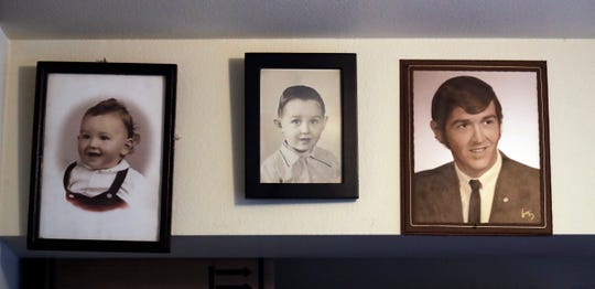 In this April 5, 2019, photo, portraits of Robert Fuller as a baby, a boy and as a young man line a wall at his home in Seattle. In May 2019, Fuller became one of about 1,200 people who have used Washington's Death with Dignity Act to end their lives in the decade since it became law.