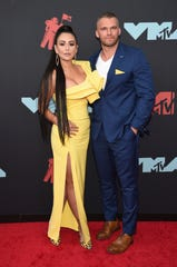 Jenni Farley, left, also known as JWoww, and Zack Clayton Carpinello arrive at the MTV Video Music Awards at the Prudential Center on Monday, Aug. 26, 2019, in Newark, N.J. (Photo by Evan Agostini/Invision/AP) ORG XMIT: NJDC142