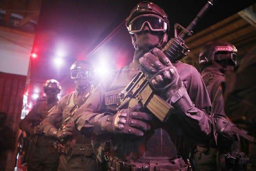 A display of police response gear is viewed in the Weedmaps Museum of Weed.