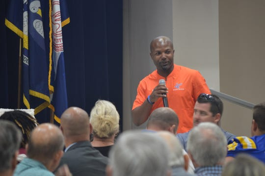 Louisiana College coach Justin Charles speaks to members and guests at the Alexandria Rotary Club meeting Tuesday at Alexandria City Hall.