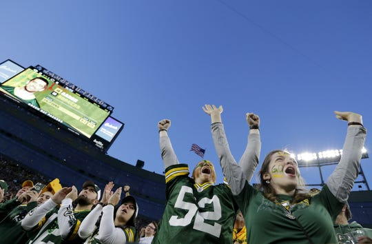 Green Bay Packers fans cheer on the team at Lambeau Field during a game in September 2018.