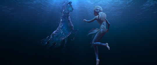 "Elsa, voiced by Idina Menzel, encounters a mythical water spirit known as a Nokk in a scene from Walt Disney Animation Studios' ""Frozen 2."""