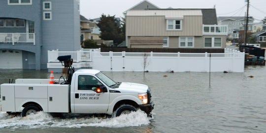 Long Beach Township truck plows through flooding on LBI