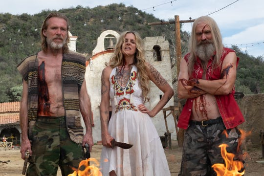 "Richard Brake as Winslow Foxworth Coltrane, from left, Sheri Moon Zombie as Baby Firefly and Bill Moseley as Otis Firefly on the set of the horror film ""3 From Hell,"" a Lionsgate/Saban Films release."