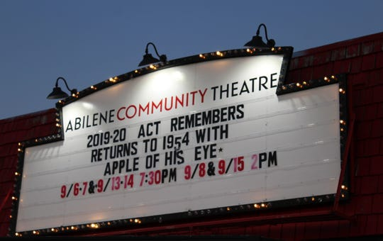 "Abilene Community Theatre's marquee sparkles in the falling night, advertising its ""ACT Remembers"" plans for the 2019-20 season."