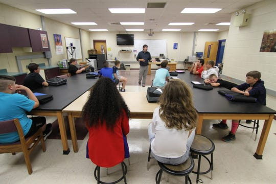 Madison County Schools Teacher of the Year Tommy Hicks engages a 7th grade class on technology and engineering.