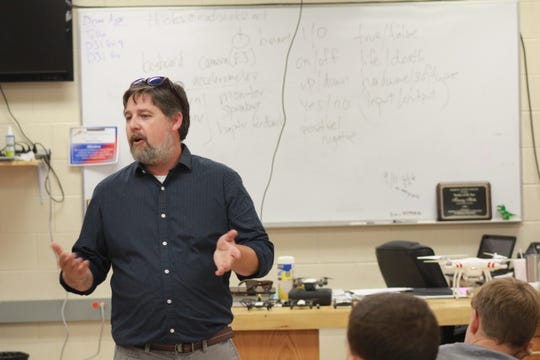 Madison County Schools Teacher of the Year Tommy Hicks teaches classes focused on technology and engineering.