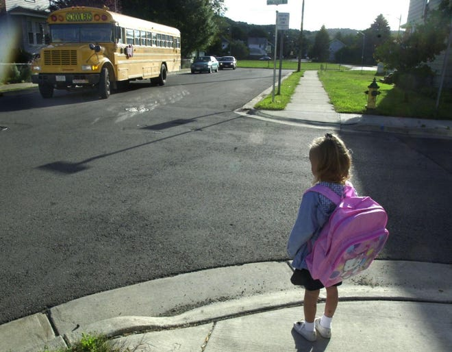 In 2001, Kaylee O'Connell waited for the school bus for her first day of school at Harry L. Johnson Elementary School. Every year since 1972, we've published David Rossie's iconic ode to the end of summer. Though things look vastly different this year, there are still lessons to be learned from his words.