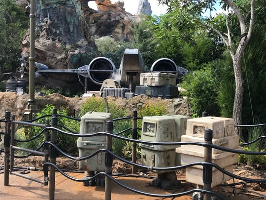 Droids stand watch in front of an X-Wing Fighter, which sits outside the Rise of the Resistance ride which opens Dec. 5.