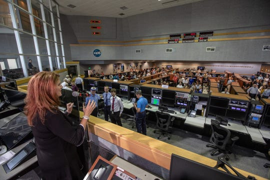 Artemis 1 Launch Director Charlie Blackwell-Thompson addresses Firing Room 1 during the 50th anniversary of the Apollo 11 moon launch at Kennedy Space Center.
