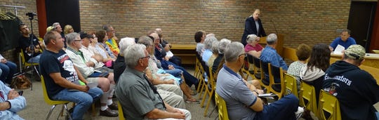 City consultant Barry Franz of Diversified Environmental Consulting speaks to a full house during a special meeting of Bucyrus City Council's public lands and buildings committee on Monday evening in council chambers.