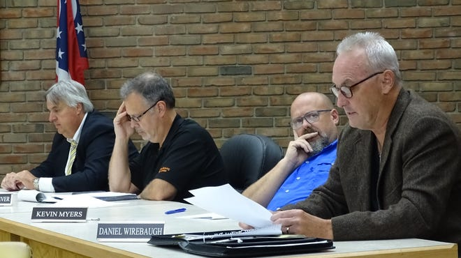 Council member Dan Wirebaugh, right, speaks during a special meeting of Bucyrus City Council's public lands and buildings committee on Monday evening in council chambers. Listening from left are Rob Ratliff, city law director; and Mark Makeever and Kevin Myers, both council members.