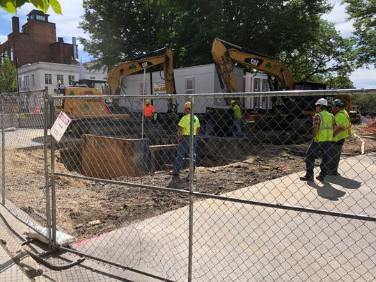 Workers dig up College Street by City Hall Park  in downtown Burlington on Tuesday, Aug. 27, 2019.