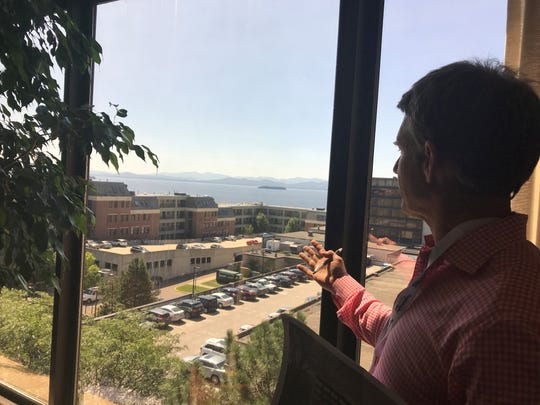 Doug Nedde checks out the view from the fourth floor of the People's United Bank building.