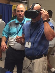 A coach uses the VAR Football goggles at the San Angelo Football Clinic in June. VAR Football uses virtual reality technology to help coaches and players.