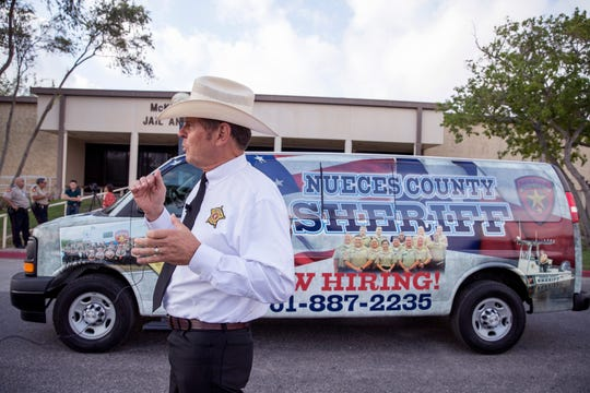 Nueces County Sheriff J.C. Hooper talks about the sheriff office's new recruitment tool, a wrapped van advertising the fact that the department is hiring for jailers, during a press conference on Tuesday, August 27, 2019. The van makes frequent trips throughout the area, which Hooper hopes will help get the message out that they are hiring.