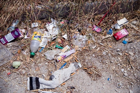 Property owners in the Leopard and North Staples streets area are frustrated by the amount of litter left around their properties. The city, a business owner, and other stakeholders are working to come up with solutions to the problem.