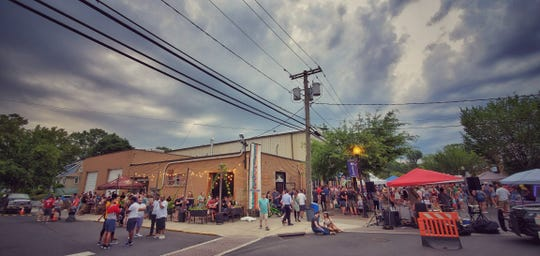 Tonewood Brewing Company's outdoor space is busy during an Oaklyn Final Friday event.
