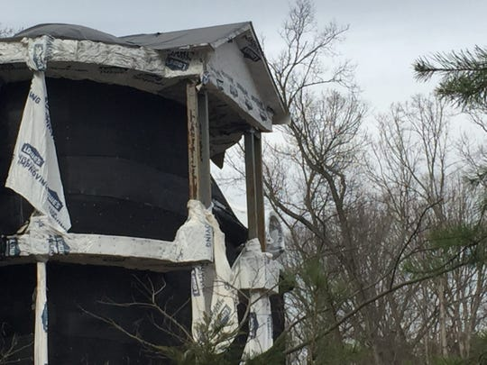 An unfinished mansion on Winding Drive in Cherry Hill was draped in black and white plastic in February 2017.