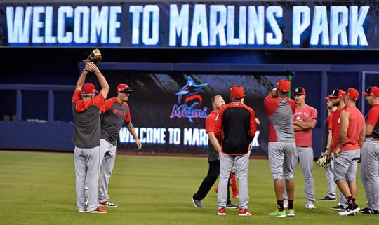 Aug 26, 2019; Miami, FL, USA; Cincinnati Reds players stretch in the outfield before a game against the Miami Marlins at Marlins Park.