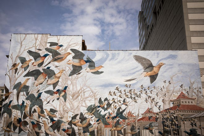 """The """"Martha, the Last Passenger Pigeon"""" mural was designed by wildlife artist and conservationist John A. Ruthven and is located at 15 E. Eighth Street in downtown Cincinnati. Martha was the last passenger pigeon and she spent her final days at the Cincinnati Zoo in 1914. ArtWorks partnered with the Cincinnati Nature Center to create this mural."""