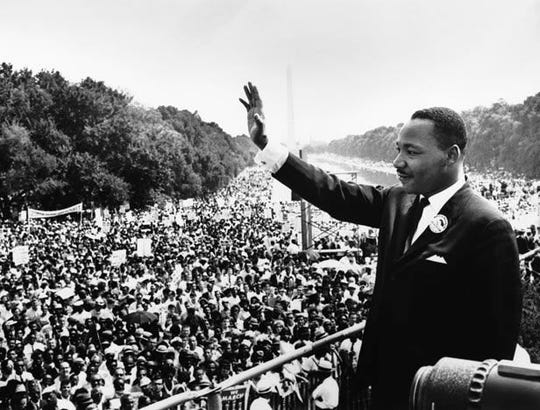"The Rev. Martin Luther King, Jr. waves to participants in the Civil Rights Movement's March on Washington from the Lincoln Memorial. It was from this spot that he delivered his famous ""I Have a Dream"" speech on August 28, 1963."