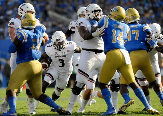 September 1, 2018; Pasadena, CA, USA; Cincinnati Bearcats running back Michael Warren II (3) runs the ball against the UCLA Bruins during the first half at the Rose Bowl.