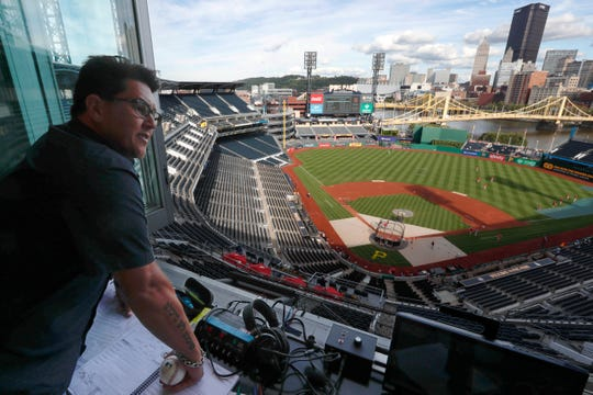 Former Cincinnati Reds pitcher Danny Graves, now a part-time radio broadcaster, looks over the field at PNC Park as the Reds take batting practice before a baseball game against the Pittsburgh Pirates, Friday, Aug. 23, 2019, in Pittsburgh. (AP Photo/Keith Srakocic)