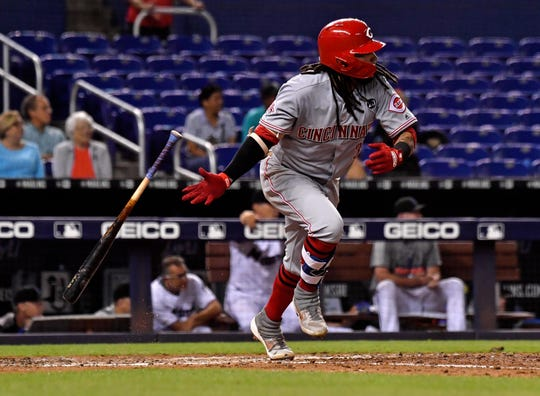 Aug 26, 2019; Miami, FL, USA; Cincinnati Reds shortstop Freddy Galvis (3) connects for a base hit in the ninth inning against the Miami Marlins at Marlins Park.