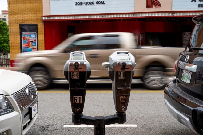 A truck drives up Franklin Street in front of a parking meter in Historic Downtown in Clarksville, Tenn., on Monday, Aug. 26, 2019.